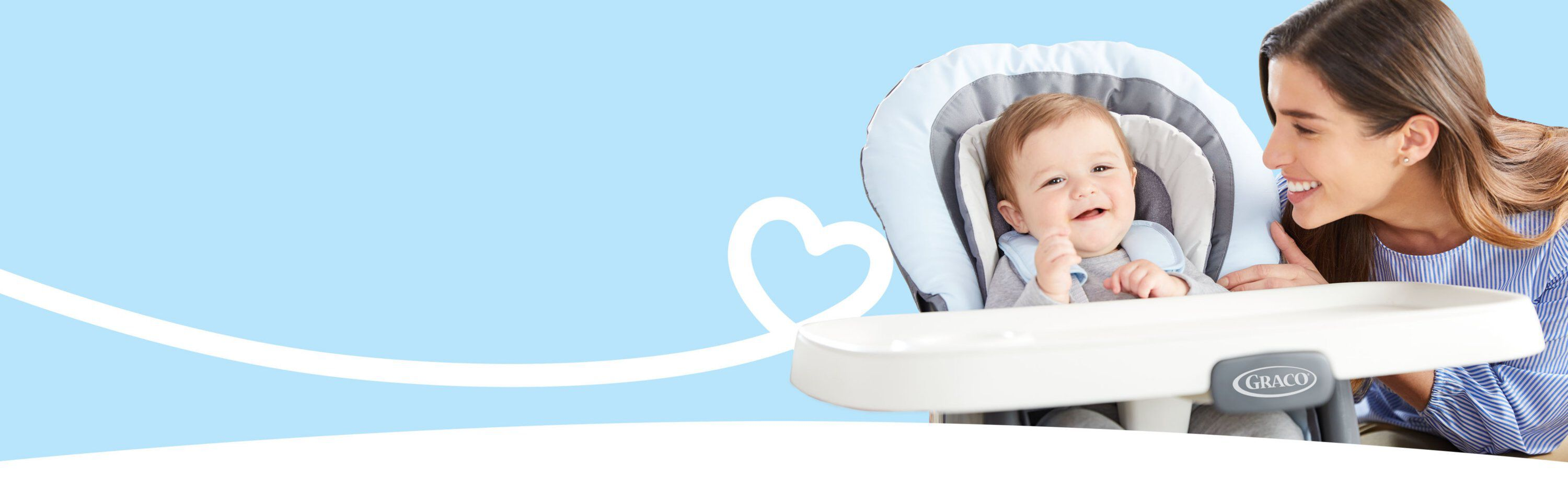 mother playing with child inside high chair banner