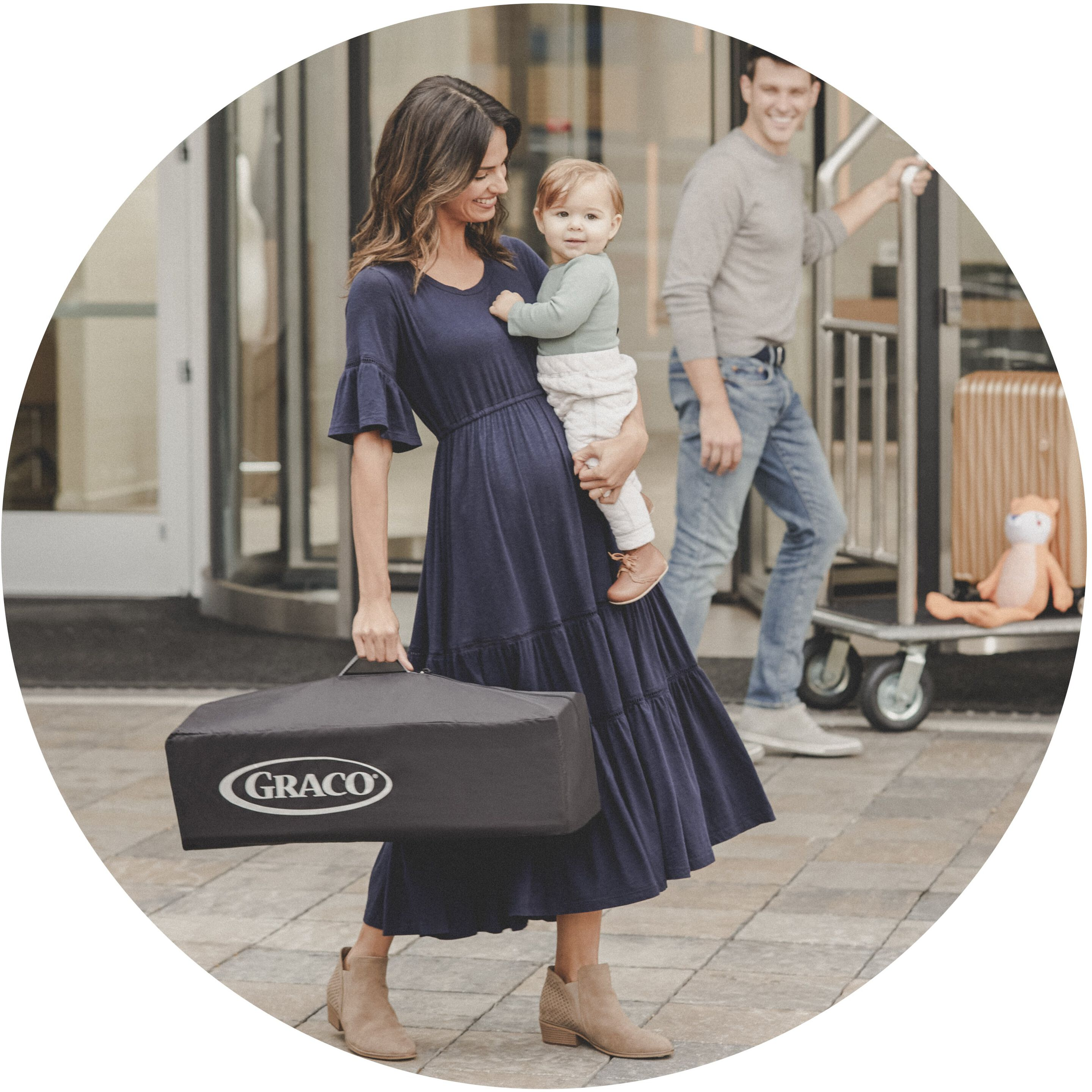 mother carrying son and play yard in carry case